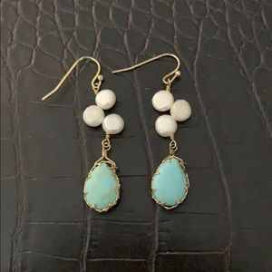 Handcrafted earrings with light blue stone